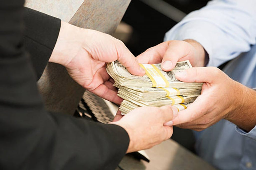 men exchanging money